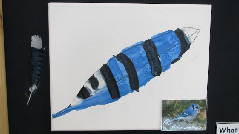 Hand-painted blue and black bird feather